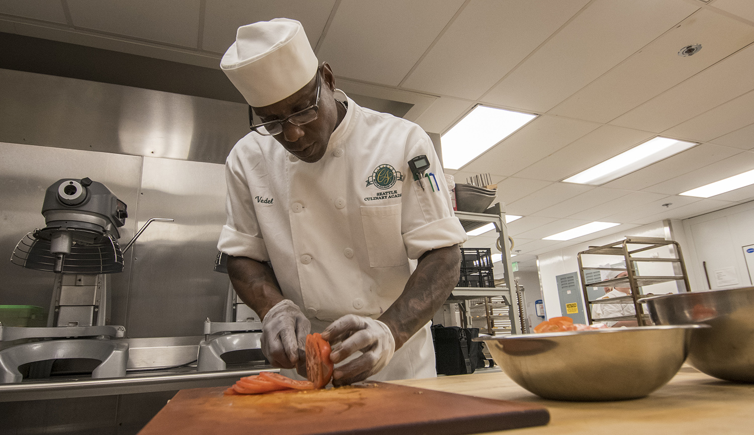 Culinary Arts student working on small plates